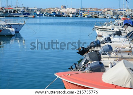 alghero harbor on a clear day - stock photo