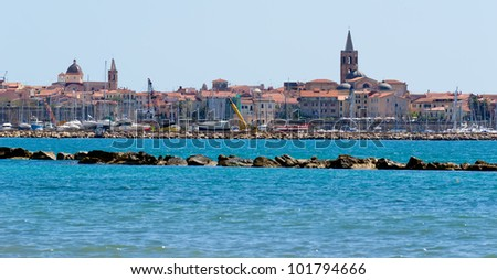 Alghero seen from the beach - stock photo