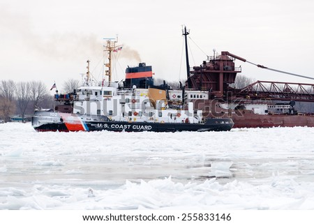 ALGONAC, MI - USA -JANUARY 11, 2015: The USCG BRISTOL BAY on January 11, 2015 working to free the HERBERT C JACKSON, which has become beset in ice on the St Clair River at Algonac, MI.