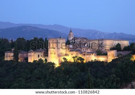 Alhambra illuminated at dusk. Granada, Andalusia Spain - stock photo