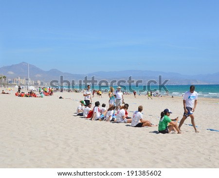 ALICANTE, SPAIN - APR 27: Murcielagos frisbee team (white/red shirts) watching Alicante's Frisbillanes play in the Ultimate Frisbee Tournament game hosted on San Juan beach in Alicante Apr 27, 2014.
