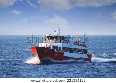 ALICANTE, SPAIN � AUGUST 18: The little touristic ferry �Kon Tiki Dos� is sailing in open waters in Alicante coast; on august 18, 2014 in Alicante. - stock photo