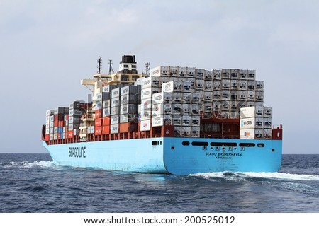 "ALICANTE, SPAIN - JUNE 16: The containership ""SEAGO BREMERHAVEN"" of Seago Lines is sailing in open water in course to Barcelona harbor, on june 16, 2014 in Alicante coast. - stock photo"