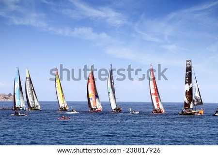 ALICANTE, SPAIN - OCTOBER 02th: Volvo Open 65 sailboats in regatta race, training day for the Open 65 sailboat class in Alicante bay, on October 02th, 2014 in Alicante. - stock photo