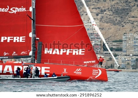 """ALICANTE, SPAIN - OCTOBER 04: The sail boat of the Team Mapfre is sailing in the """"Volvo Ocean Race 2014-2015"""" in-port race in Alicante bay, on october 04, 2014 in Alicante. - stock photo"""