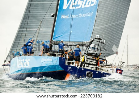 ALICANTE, SPANE - OCTOBER 11, 2014: Volvo Ocean Race. Leg start. Fleet out to sea, then rounded the last inshore mark just outside the harbour.