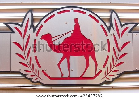 ALICE SPRINGS, AUSTRALIA - November 28. Logo of the Ghan passenger train which connects Alice Springs with Katherine, Darwin and Adelaide on November 28, 2013 in Alice Springs.  - stock photo