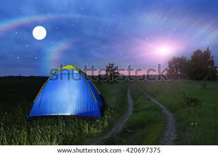 Alien spaceship - UFO over the field at night. C&ing tent glows under a night & Alien Spaceship Ufo Over Field Night Stock Photo 420697375 ...