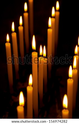 Alight candles over the black background.