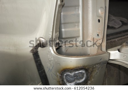 Align metal body car with hammer in automotive industry - auto body repair