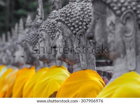 aligned buddha statues at Wat Yai Chaimongkol Ayutthaya - stock photo