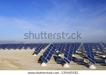 aligned photovoltaic panels for renewable electricity production - stock photo