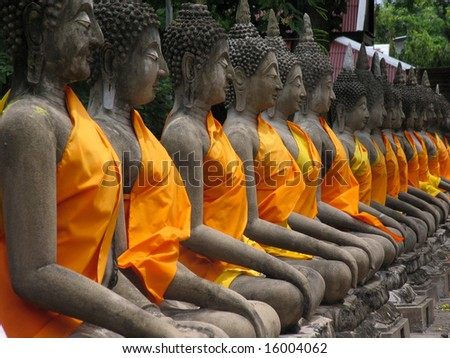 Aligned statues of Buddha - stock photo