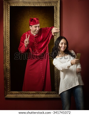 Alive portrait of a medieval priest and a visitor of the gallery taking selfie photo together