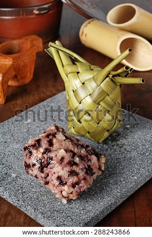 Alivongvong  (meat and sticky rice dumpling packed in leaves)  - stock photo