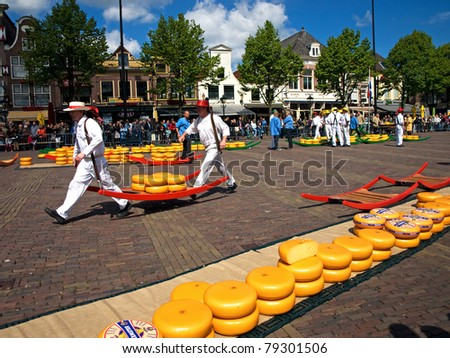 ALKMAAR, BELGIUM - MAY 14: Cheese porters at the cheese market in Alkmaar, The Netherlands on May 14, 2010. The tradition of cheese trade and first weighing houses date from XIV century.