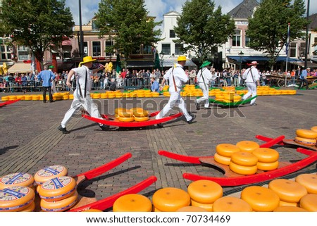 ALKMAAR, HOLLAND, THE NETHERLANDS - SEPTEMBER 3: Cheese workers walking to a lorry. This traditional market is held a few Fridays during Summer. September 3, 2010 in Alkmaar, Holland, The netherlands