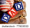 All American dad - wooden blocks in a baseball glove with an American flag wrapped baseball - concept for Father's Day - stock photo