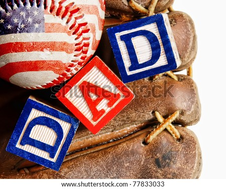 All American dad - wooden blocks in a baseball glove with an American flag wrapped baseball - concept for Father's Day