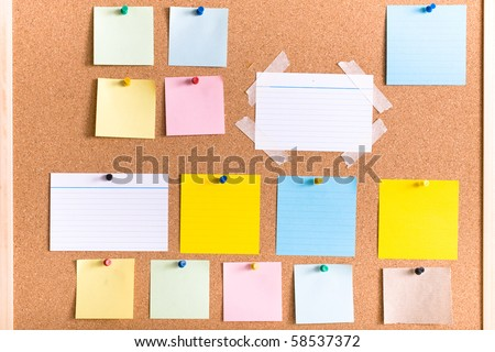 all different types of notes on cork board, blank, stripped, attached with pin and tape - stock photo