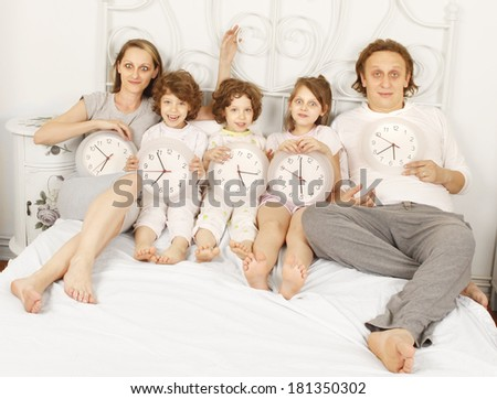 All family together awake in the bed - stock photo