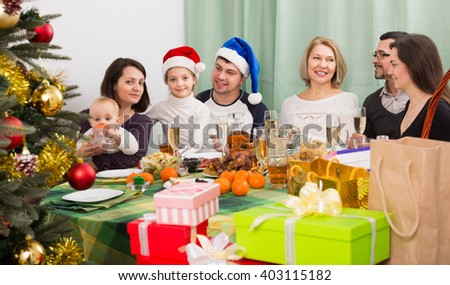 All family together celebrating Christmas with mom dad and kids;