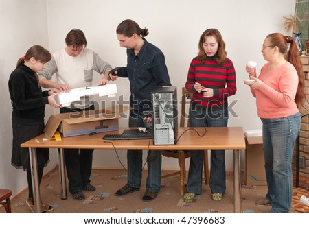 All family was gathered to look at the new computer. - stock photo