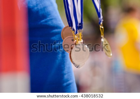 All kind of medals in the air with wonderful colors. Nice picture for olympic games in Rio - stock photo