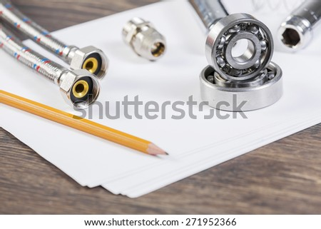 All kinds of plumbing and tools on sheet of paper - stock photo
