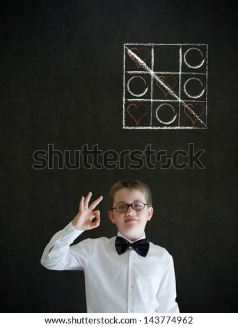 All ok or okay sign boy dressed up as business man with chalk tic tac toe love valentine concept on blackboard background - stock photo