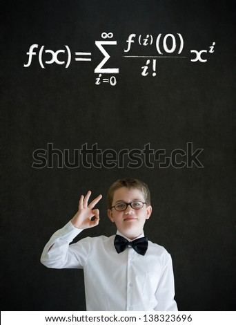 All ok or okay sign boy dressed up as business man with maths equation on blackboard background - stock photo