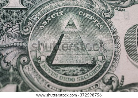 all-seeing eye, truncated pyramid closeup, money background ,one dollar bill down back reverse side, background of dollars, close up, America - stock photo