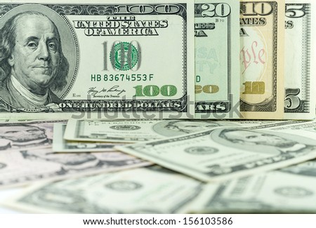 all stack type of american dollars on many dollars background - stock photo