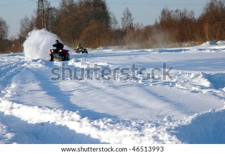 all terrain vehicle in motion at winter - stock photo