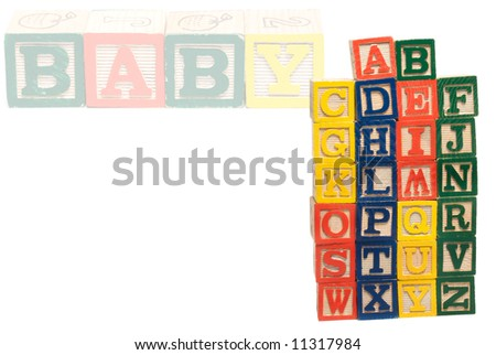 All the letters of the alphabet piled into a tower, using wooden baby blocks - stock photo