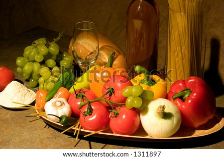All the makings of a fine Italian meal.  Featuring tomatoes, garlic, peppers, onion, etc. - stock photo