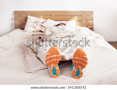 All time ready to run. Runner sleep in comfort run shoes - stock photo