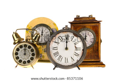 All vintage clocks at twelve hours isolated over white - stock photo