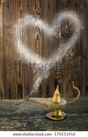 Alladin's lamp with smoke heart, a Valentines Day theme. - stock photo