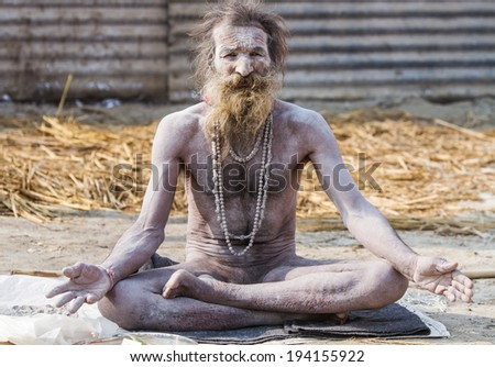 ALLAHABAD, INDIA - FEB 13 - A hardcore Hindu renunciate sits in meditation during the festival of Kumbha Mela on February 13th 2013 at Allahabad, India.