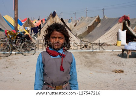 ALLAHABAD, INDIA - JAN 26: Unidentified girl at the camp town, builded for the biggest festival in the world - Kumbh Mela, on January 26, 2013 in Allahabad, India. The festival is held every 12 years - stock photo
