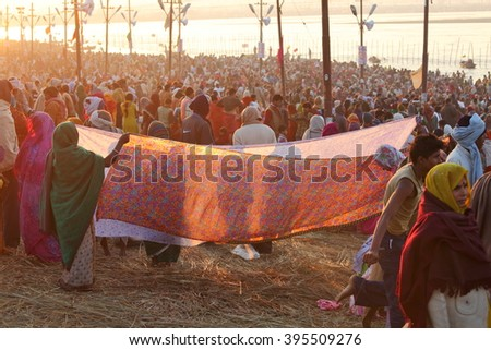 ALLAHABAD, UTTAR PRADESH, INDIA - FEBRUARY 08, 2013: Women put their sari out to dry on wind after ritual holy bathing in the Ganges river during the festival Kumbh Mela - stock photo