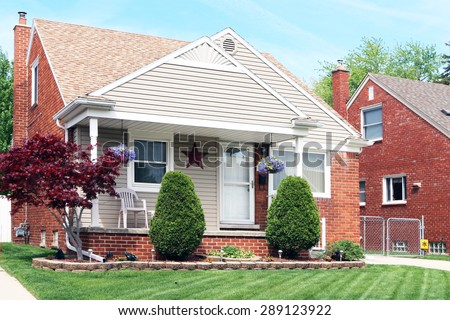 ALLEN PARK, MICHIGAN-JUNE, 2015:  Suburban house in a Detroit suburb built in the 1950's.  Homes like this were popular with soldiers returning from World War II. - stock photo