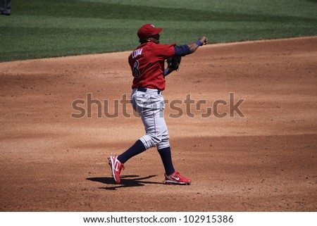 ALLENTOWN, PA - APRIL 29: Lehigh Valley Ironpigs' third baseman Hector Luna makes a throw in a game against Scranton Wilkes Barre Yankees the at Coca-Cola Field on April 29, 2012 in Allentown, PA. - stock photo