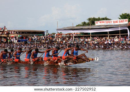 ALLEPPEY, INDIA - AUG 09 : Snake boat teams competing in the most popular Nehru Trophy Boat race held in August 09, 2014 in Alleppey,Kerala, India. - stock photo