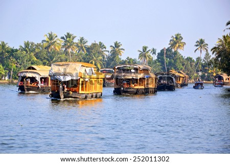 ALLEPPEY, INDIA - FEBRUARY 1, 2015: Houseboats were used in the early days for the transport of goods and now are providing cruise in backwaters tour. - stock photo