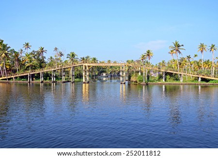 ALLEPPEY, INDIA - FEBRUARY 1, 2015: Kerala backwaters are a chain of lagoons and lakes lying parallel to the Arabian Sea coast of Kerala state. - stock photo