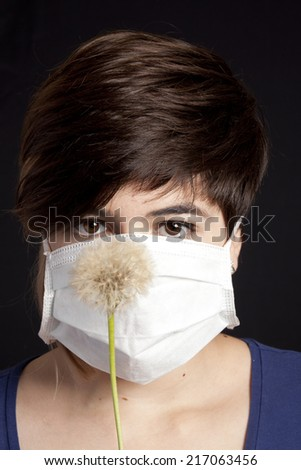 allergy - girl with dandelion - stock photo