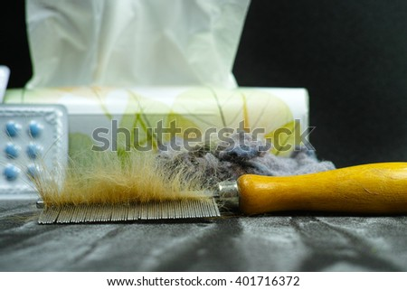 Allergy relief concept, home pets hair and dust as  allergens, medication and paper tissues, copy space - stock photo