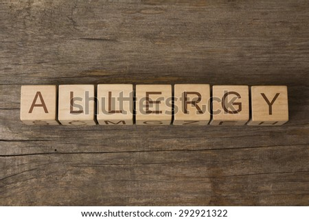 allergy word on wooden cubes - stock photo